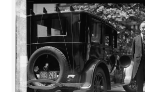 President Coolidge shows off his radio-equipped auto.
